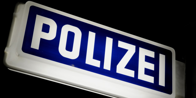 German police station sign in blue and white