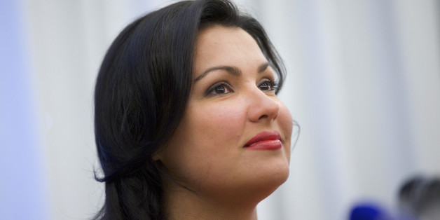 Russian leading operatic soprano Anna Netrebko speaks at a news conference in Moscow on Tuesday, June 18, 2013. Netrebko and Russian leading baritone opera singer Dmitry Khvorostovsky will take part in a concert  at Moscow's Red Square on Wednesday.   (AP Photo/Ivan Sekretarev)