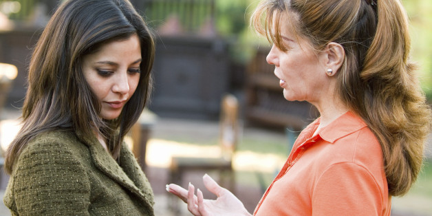 Woman lecturing daughter