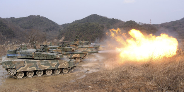"South Korean army K-2 tanks fires during a live firing drill at a fire training field in Yangpyeong, South Korea, Thursday, Feb. 18, 2016. North Korean leader Kim Jong Un recently ordered preparations for launching ""terror"" attacks on South Koreans, a top Seoul official said Thursday, as worries about the North grow after its recent nuclear test and rocket launch. (Jang Se-young/Newsis via AP) KOREA OUT"