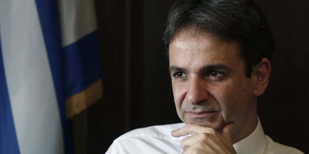 """Greek Administrative Reform Minister Kyriakos Mitsotakis listens during an interview with the Associated Press in Athens, Tuesday, April 8, 2014. Mitsotakis said years of austerity have left Greece with about 200,000 fewer civil servants than before its debt crisis erupted in late 2009. He added that  the country has made significant overall progress, which should allow it to tap international capital markets """"in the foreseeable future."""" (AP Photo/ Petros Giannakouris)"""