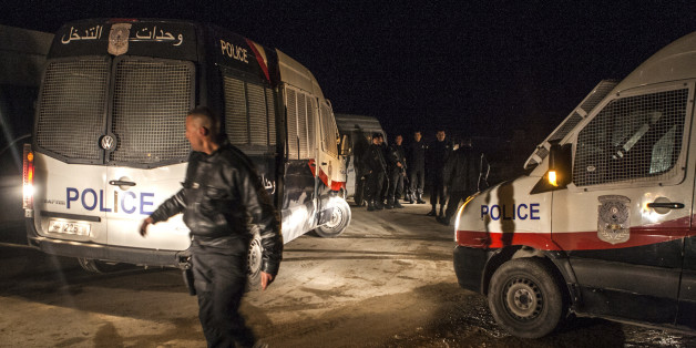 Police forces patrol near a house where suspected Islamist militants were hidden in Raoued, near Tunis, Monday night Feb. 3, 2014. Tunisia's police exchanged gunfire with a group of suspected Islamic militants holed up in a house in a suburb near the capital on Tuesday, leaving two militants and a policeman dead, an Interior Ministry spokesman said Tuesday Feb. 4, 2014. (AP Photo/Aimen Zine)