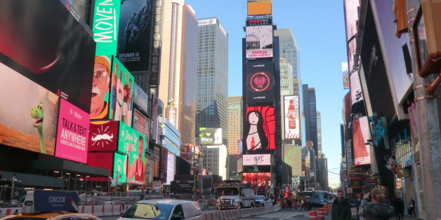 Times Square is a major commercial intersection in Midtown Manhattan, at the junction of Broadway and 7th Avenue, and stretching from West 42nd to West 47th Streets.  Brightly adorned with billboards and advertisements, Times Square is  one of the world's most visited tourist attractions, drawing an estimated fifty million visitors annually. Approximately 330,000 people pass through Times Square daily, many of them tourists.