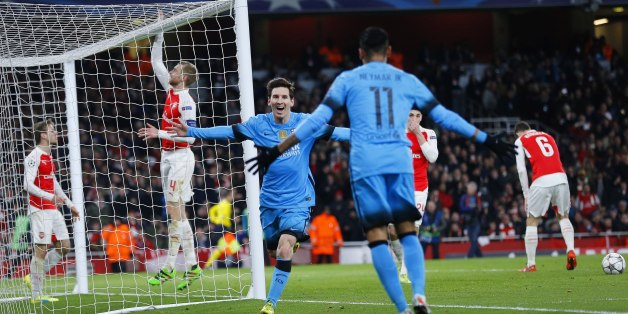 Barcelona's Lionel Messi celebrates after he scored the opening goal during the soccer Champions League round of 16 first leg soccer match between Arsenal and Barcelona at the Emirates stadium in London, Tuesday, Feb. 23, 2016. (AP Photo/Frank Augstein)