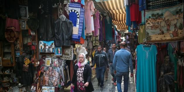 People walk through the Medina market in Tunis, Tunisia, Monday, Oct. 26, 2015. (AP Photo/Mosa'ab Elshamy)