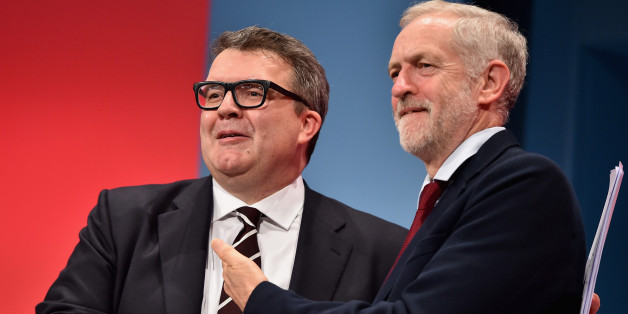 BRIGHTON, ENGLAND - SEPTEMBER 30:  Deputy Leader of the Labour party Tom Watson takes applause with Labour Leader Jeremy Corbyn following his closing speech on the final day of the Labour Party Autumn Conference on September 30, 2015 in Brighton, England. On the fourth and final day of the annual Labour Party Conference, delegates will debate and vote on an emergency motion detailing strict conditions for the support of military action in Syria, as well as attending talks on healthcare and educa