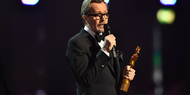 Gary Oldman accepts the Brits Icon Award on behalf of the late David Bowie on stage during the 2016 Brit Awards at the O2 Arena, London.