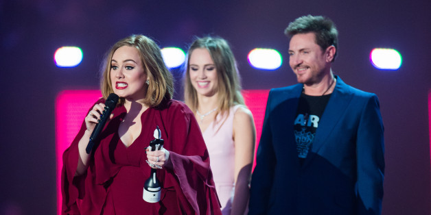 LONDON, ENGLAND - FEBRUARY 24:  Adele accepts her British Single from Suki Waterhouse and Simon Le Bon at the BRIT Awards 2016 at The O2 Arena on February 24, 2016 in London, England.  (Photo by Samir Hussein/Redferns)