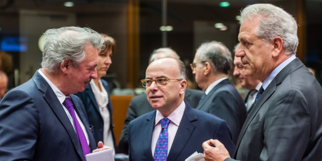 French Interior Minister Bernard Cazeneuve, center, talks with European Commissioner for Migration and Home Affairs Dimitris Avramopoulos, right, and Luxembourg's Minister of Foreign and European Affairs Jean Asselborn during an EU justice and home affairs council at the EU Council building in Brussels on Thursday, Feb. 25, 2016. (AP Photo/Geert Vanden Wijngaert)
