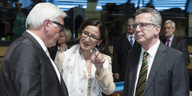German Foreign Minister Frank-Walter Steinmeier, left, speaks with Austrian Justice Minister Johanna Mikl-Leitner, center, and German Justice Minister Thomas de Maiziere  during a meeting of EU foreign ministers at the EU Council building in Luxembourg on Monday, April 20, 2015. An Italian coast guard ship headed toward Sicily Monday to look for survivors of a capsized ship in what could be the Mediterranean's deadliest migrant tragedy, as EU foreign ministers gathered for an emergency meeting to discuss the crisis. (AP Photo/Thierry Monasse)