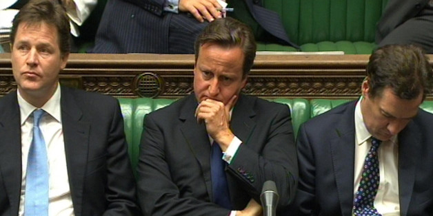 Prime Minister David Cameron, Deputy Prime Minister Nick Clegg (left) and Chancellor George Osborne (right) react during Prime Minister's Questions in the House of Commons, London.