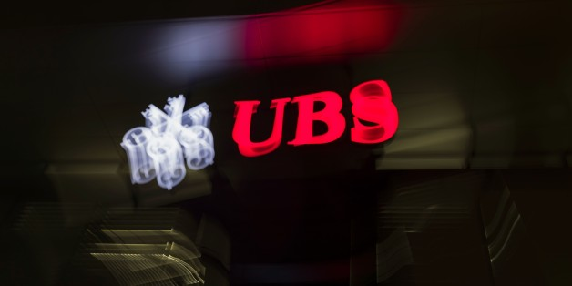 A picture taken on February 25, 2016 shows the logo of the Swiss global financial services company UBS at the entrance of a branch's building in Zurich. / AFP / FABRICE COFFRINI        (Photo credit should read FABRICE COFFRINI/AFP/Getty Images)