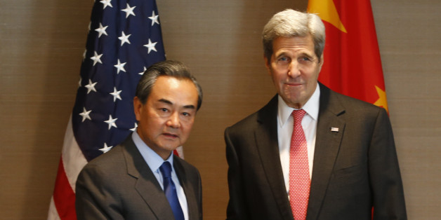 US Secretary of State John Kerry, right, shakes hands with China's  Froreign, Minister Wang Yi,  during a meeting in Munich, Germany prior to the start of the Munich Security Conference, Friday Feb. 12, 2016. (AP Photo/Matthias Schrader)