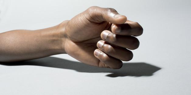 Black man's hand on grey