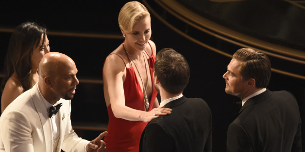 Common, from left, Charlize Theron, Tobey Maguire, and Leonardo DiCaprio are seen in the audience at the Oscars on Sunday, Feb. 28, 2016, at the Dolby Theatre in Los Angeles. (Photo by Chris Pizzello/Invision/AP)