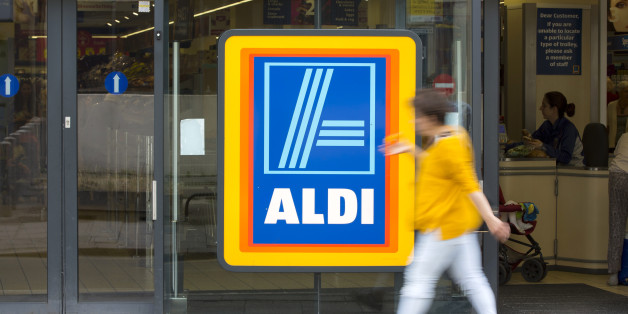 A pedestrian walks past the entrance to an Aldi supermarket store in London, U.K., on Monday, June 29, 2015. The growth of Aldi and fellow German-owned discounter Lidl has changed the British grocery landscape over the last five years. Photographer: Jason Alden/Bloomberg via Getty Images
