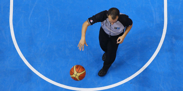 SIAULIAI, LITHUANIA - SEPTEMBER 05: A basketball referee hols the ball during the EuroBasket 2011 first round group B match between Latvia and Germany at Siauliai Arena on September 5, 2011 in Siauliai, Lithuania. (Photo by Christof Koepsel/Bongarts/Getty Images)