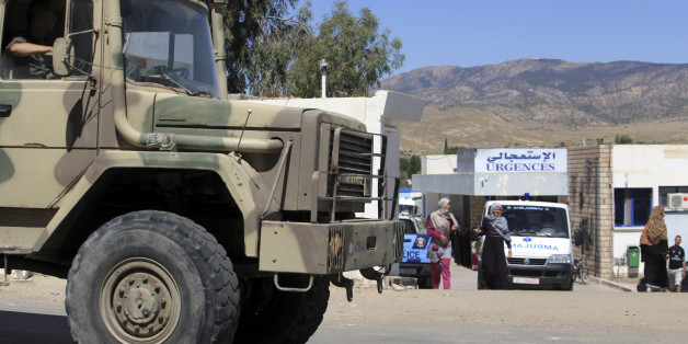 A military truck parks outside the hospital of Kasserine, near the Algerian border, Thursday, July 17, 2014. Militants in western Tunisia staged two simultaneous attacks on army posts while soldiers held a Ramadan feast, killing at least 14 soldiers, authorities said Thursday. (AP Photo/ Mouldi Kraeim)