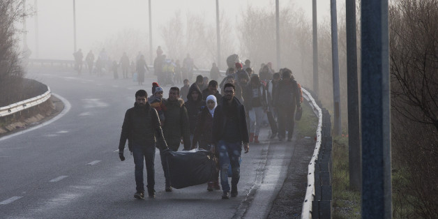 Syrian refugees walk through a motorway towards the Greek border station of Idomeni Tuesday, March, 1 2016. Some 7,000 migrants, including many from Syria and Iraq, are crammed into a tiny camp at the Greek border village of Idomeni, and hundreds more are arriving daily. (AP Photo/Petros Giannakouris)