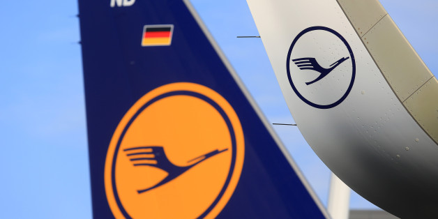 The Deutsche Lufthansa AG logo sits on the wing and tailfin of an Airbus A320neo aircraft during a delivery ceremony outside the Airbus Group SE factory in Hamburg, Germany, on Friday, Feb. 12, 2016. Lufthansa, the sole airline so far to take delivery of the new A320neo model, will limit the plane to domestic German routes until glitches with the engine cooling system are resolved in coming weeks. Photographer: Krisztian Bocsi/Bloomberg via Getty Images