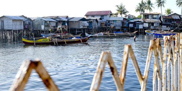 Boats are moored in front of houses on stilts in the Isla Verde shantytown of Davao, Mindanao, the Philippines, on Friday, Dec. 11, 2015. Davao city's reputation as one of the safest, most vibrant and best-run cities in the country is drawing migrants and business people in their thousands. It has become a victim of its own success, and an archetype of modern urbanization in developing countries, where inward migration is outstripping governments' ability to supply infrastructure and services. Photographer: Veejay Villafranca/Bloomberg via Getty Images