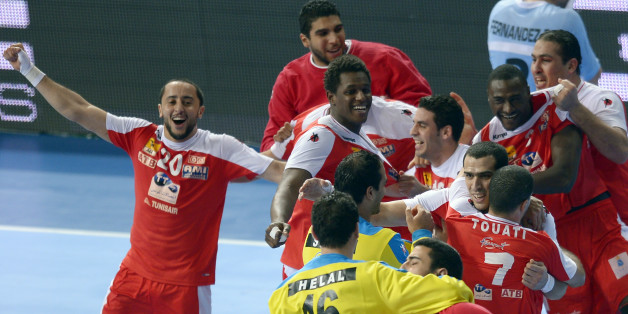 Tunisia's players celebrate their victory over Argentina during a preliminary round Group A Men's World Handball championship match in Barcelona, Spain, Friday, Jan. 18, 2013. (AP Photo/Manu Fernandez)