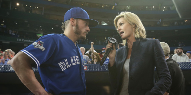 TORONTO, CANADA - OCTOBER 21: Josh Donaldson #20 of the Toronto Blue Jays is interviewed by Erin Andrews of Fox Sports after their victory against the Kansas City Royals during game five of the American League Championship Series at Rogers Centre on October 21, 2015 in Toronto, Ontario, Canada. (Photo by Tom Szczerbowski/Getty Images)