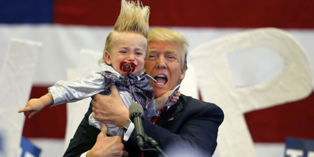 Republican presidential candidate Donald Trump holds up a child he pulled from the crowd as he arrives to speak at a campaign rally in New Orleans, Friday, March 4, 2016. (AP Photo/Gerald Herbert)