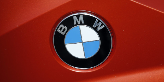 "The BMW logo of a motorcycle in a showroom in London, Thursday, March 3, 2016. The chief executive of Rolls-Royce has told the company's British staff that business could be harmed if the U.K. leaves the European Union. Torsten Muller-Otvos says the EU's free-trade arrangements help the firm, which is owned by Germany's BMW Group. In a letter to staff at Rolls-Royce and Mini, which is also BMW-owned, he says that ""tariff barriers would mean higher costs and higher prices.""(AP Photo/Frank Au"