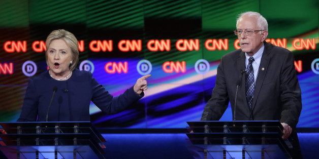 Democratic presidential candidate, Hillary Clinton argues a point as Sen. Bernie Sanders, I-Vt., right, listens during a Democratic presidential primary debate at the University of Michigan-Flint, Sunday, March 6, 2016, in Flint, Mich. (AP Photo/Carlos Osorio)