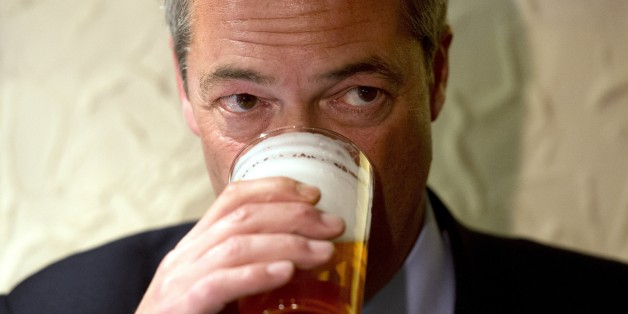 Nigel Farage, leader of the UK Independence Party (UKIP), enjoys a pint of beer in The Gardeners Arms pub after unveiling campaign posters ahead of the Heywood and Middleton by-election in Heywood, Greater Manchester, on October 7, 2014.  AFP PHOTO / OLI SCARFF        (Photo credit should read OLI SCARFF/AFP/Getty Images)