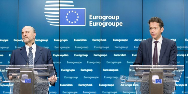 EU Economic and Financial Affairs, Taxation and Customs Commissioner Pierre Moscovici (L) and Eurogroup President and Dutch Finance Minister Jeroen Dijsselbloem address a press conference following a meeting of Eurogroup ministers at the European Council headquarters in Brussels on February 11, 2016.  / AFP / THIERRY MONASSE        (Photo credit should read THIERRY MONASSE/AFP/Getty Images)