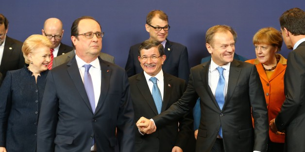 BRUSSELS, BELGIUM - MARCH 7: Turkish Prime Minister Ahmet Davutoglu (C), French President Francois Hollande (L 2), President of the European Council, Donald Tusk (R 3), Lithuanian President Dalia Grybauskaite (L) and Dutch Prime Minister Mark Rutte (R) pose for a photo after the EU-Turkey summit in Brussels, Belgium on March 7, 2016. 