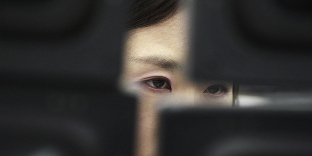 FILE - In this Tuesday, Feb. 4, 2014, file photo, a currency trader watches monitors at the Korea Exchange Bank headquarters in Seoul, South Korea. The Treasury Department reports on foreign holdings of U.S. debt for November 2015, on Tuesday, Jan. 19, 2016. (AP Photo/Ahn Young-joon, File)