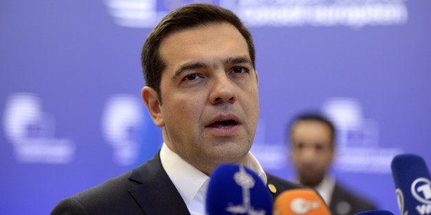 Greek Prime Minister Alexis Tsipras talks to the media at the end of the European Summit  in Brussels February 20, 2016. European leaders sealed a deal with the UK after hours of haggling at a marathon summit, paving the way for a referendum on whether Britain will stay in the EU. The European Union's two top figures, Donald Tusk and Jean-Claude Juncker, presented its 28 leaders with draft proposals at a long-delayed dinner after hours of painstaking face-to-face talks on an issue that threatened place in the union.  / AFP / THIERRY CHARLIER        (Photo credit should read THIERRY CHARLIER/AFP/Getty Images)