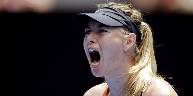 Maria Sharapova of Russia celebrates after winning a point against Serena Williams of the United States during their quarterfinal match at the Australian Open tennis championships in Melbourne, Australia, Tuesday, Jan. 26, 2016.(AP Photo/Aaron Favila)