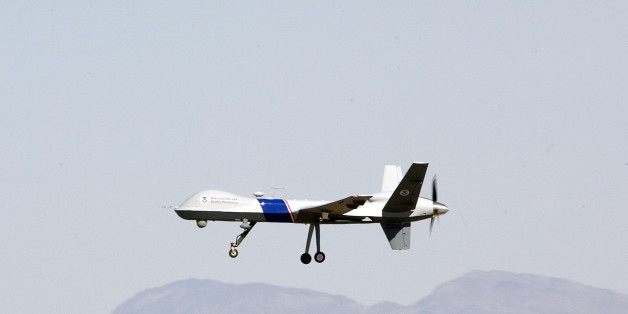 The new U.S. Customs and Border Protection unmanned aircraft the MQ-9 Predator is shown in flight at Fort Huachuca Army base, in Sierra Vista, Ariz., Monday, Oct. 30, 2006. (AP Photo/John Miller)