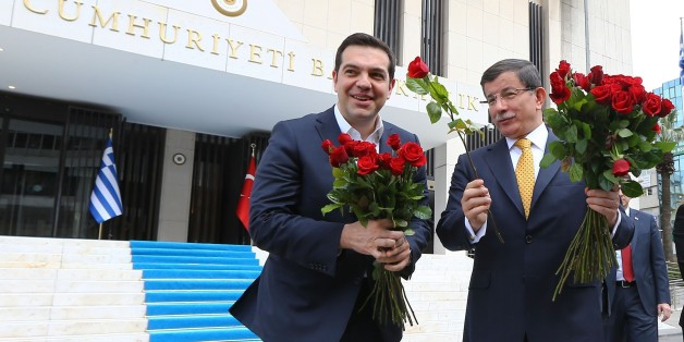 IZMIR,TURKEY - MARCH 08:  Turkish Prime Minister Ahmet Davutoglu (right) welcomes Greek Prime Minister Alexis Tsipras (left) give red roses to the female journalists to mark International Women's Day prior to their meeting at the Prime Ministry Office in Izmir, Turkey on March 08, 2016. (Photo by Hakan Goktepe/Anadolu Agency/Getty Images)