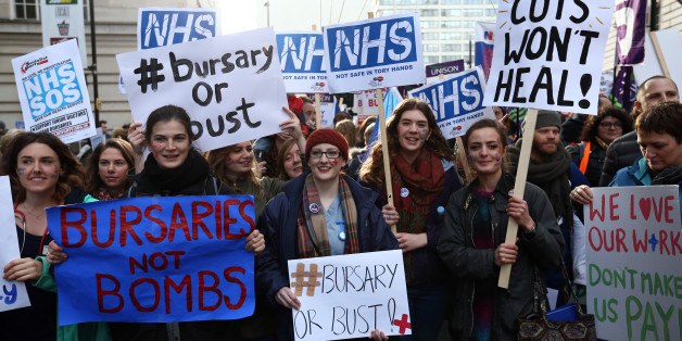 LONDON, ENGLAND - JANUARY 09: Student nurses and health workers take part in a demonstration against government plans to scrap the NHS bursary on January 9, 2016 in London, England. The government are proposing to scrap the bursary and from 2017, are asking future nurses, midwives and other allied health professionals to pay up to £50,000 to train to care. Future nurses and midwives will find it extremely difficult if not impossible to pay this debt off.  (Photo by Carl Court/Getty Images)