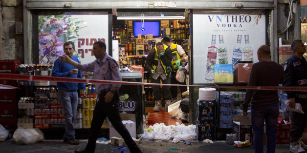 Israeli ZAKA emergency response members are seen at the scene of a stabbing attack in the central Israeli city of Petah Tikvah,  Tuesday, March 8, 2016. A Palestinian opened fire at Israeli police officers outside Jerusalem's Old City on Tuesday, seriously wounding two of them before being shot dead, police said. Another Palestinian was shot dead after attacking Israeli security forces with a knife in the Old City, and a third was shot and killed after stabbing an Israeli in the central city of Petah Tikvah, according to police. (AP Photo/Sebastian Scheiner)