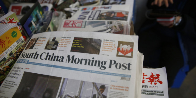 Copies of South China Morning Post are sold at a news stand in Hong Kong, Friday, Dec. 11, 2015. Chinese e-commerce giant Alibaba says it's buying Hong Kong's leading English language newspaper, the South China Morning Post. Alibaba Group said late Friday it signed a deal with publisher SCMP Group to buy the Post and the company's other media assets, which also include magazines, outdoor advertising and digital media. (AP Photo/Kin Cheung)