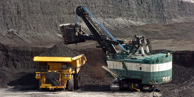 FILE - In this April 4, 2013 file photo, a mechanized shovel loads coal onto a haul truck at the Cloud Peak Energy's Spring Creek mine near Decker, Mont. An Obama administration effort to overhaul coal sales from public lands will be put to its first test as companies seek to advance two major mining projects in the Western U.S. Federal and state officials are meeting Wednesday, Jan. 27, 2016, to consider the request. Cloud Peak Energy and Lighthouse Resources Inc. wants to mine a combined 644 m