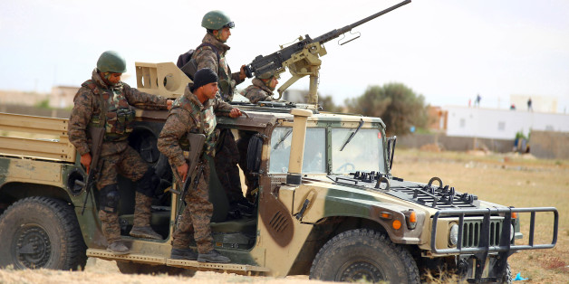 Tunisian soldiers patrol as they search for attackers still at large in the outskirts of Ben Guerdane, southern Tunisia, Tuesday, March 8, 2016. The death toll from clashes between Tunisian forces and extremist attackers near the Libyan border has risen to 55, including 36 attackers, Tunisian Prime Minister Habid Essid said Tuesday. (AP Photo)