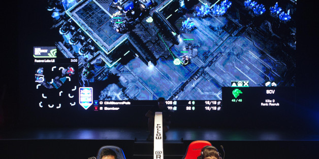 "FILE - In this July 13, 2014 file photo, Choi Seong Hun, left, who goes by the gaming name ""PoLt"" and Choi Ji Sung, known as ""Bomber,"" both of South Korea, are separated by a divider as they compete against each other in the finals of the Red Bull Battle Grounds ""StarCraft II"" video game tournament in Atlanta. The next ally in competitive gaming's fight for mainstream awareness might be marketers. At an invite-only gathering of marketing executives Wednesday, May 6, 2015, representatives fr"