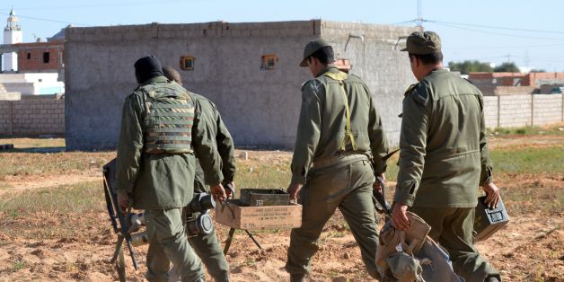 Tunisian special forces carry boxes of ammunition left behind by jihadists in the southern town of Ben Guerdane, near the Libyan border, during clashes with jihadists on March 8, 2016 a day after the attack on the border town.
