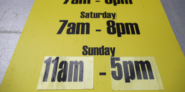 LONDON, ENGLAND - JULY 14:  Store opening times are displayed on July 14, 2015 in London, England. Chancellor George Osborne is planning to relax a 21 year old law meaning that shops in England and Wales could be allowed to stay open longer on Sundays.  (Photo by Dan Kitwood/Getty Images)