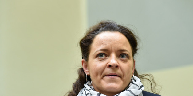 Defendant Beate Zschaepe waits for the continuation of her trial at a courtroom in Munich, southern Germany, March 2, 2016. The lone surviving suspect in a neo-Nazi murder case that shocked Germany is accused of helping found a neo-Nazi cell, the National Socialist Underground (NSU), and of complicity in the murders of eight Turks, a Greek and a German police woman across Germany between 2000 and 2007, as well as two bombings in immigrant areas of Cologne and 15 bank robberies. / AFP / POOL / CH