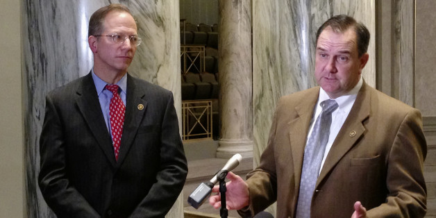 Missouri Senate Majority Leader Mike Kehoe talks with reporters as Republican Sen. Bob Onder looks on Wednesday, March 9, 2016, at the Missouri Capitol in Jefferson City. Republican senators used a rare procedural move to shut off a Democratic filibuster and force a vote Wednesday on a proposed state constitutional amendment sponsored by Onder. The measure would prohibit government penalties against some businesses and individuals who cite religious beliefs while declining to provide wedding-rel