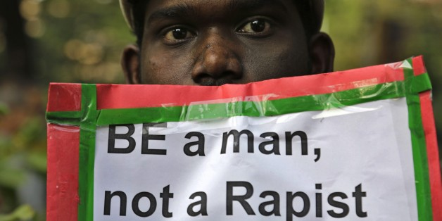 A man holds a placard as Indian Christians and others condemn the gang rape of a nun at a Christian missionary school in eastern India in Kolkata, India, Monday, March 16, 2015. According to police a nun in her 70s was gang-raped by a group of bandits when she tried to prevent them from committing a robbery in the Convent of Jesus and Mary School in West Bengal state's Nadia district. The attack early Saturday is the latest crime to focus attention on the scourge of sexual violence in India. (AP