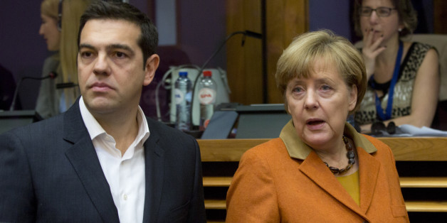 German Chancellor Angela Merkel, right, and Greek Prime Minister Alexis Tsipras arrive for a round table meeting during an EU summit at EU headquarters in Brussels on Sunday, Oct. 25, 2015. EU leaders meet on Sunday to discuss refugee flows along the Western Balkans route. (AP Photo/Virginia Mayo)